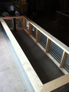 How to build a raised bed. Design by Steve Flannery  These raised beds are for community garden downtown. Materials used, Galvanized Metal, Wood Screws, Metal Plates, 2X4 Wood, 2X6 Wood. All wood untreated ( This is for veggies. )   You can easily make your own box. See plan file here. https://www.dropbox.com/sh/x4qzibq43umgmnt/QD4akXjCZs