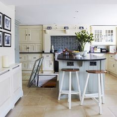 Perfect harmony is created in this modern country kitchen with a colour palette of soft blue with cream units and stone floor tiles. In my dream kitchen the trap door in the floor opens up to a wine cellar. http://www.housetohome.co.uk/kitchen/picture/country-kitchen-diner-3
