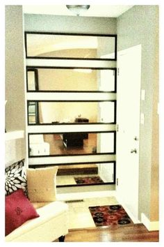 Cheap over the door mirror attached sideways. I can see a long table at entry way with one mirror.
