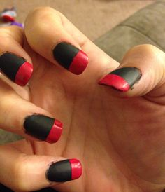 Dark grey with reddish pink tips