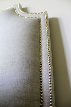 Easy DIY upholstered headboard nail head trim tutorial