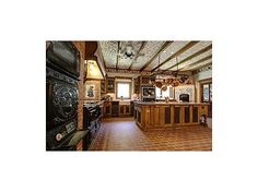Enter on a cobble stone driveway to this magical European Style Home located on desireable Upper Bear Creek. Walk thru a vaulted entry with a stained glass rotunda, hand carved arched doorway and iron gate. The main house features an antique \'Brides Door\', European style plaster walls, Brick floors and massive \'reclaimed wood\' beams. #zillow