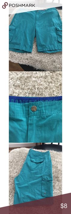 Men's Board Shorts by Paradise Shores Sz 42 Men's board shorts.  Turquoise color.  Cargo pockets.  From Paradise Shores.  Size 42.  Good condition.  Important:   All items are freshly laundered as applicable prior to shipping (new items and shoes excluded).  Not all my items are from pet/smoke free homes.  Price is reduced to reflect this!   Thank you for looking! Paradise Shores Shorts Flat Front