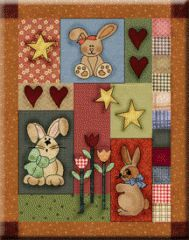 Bunny Trio | This set of springtime bunnies in a scrappy setting are perfect for Easter or for that special toddler's bedroom. Mix and match plaids and homespuns for that charming country style.