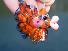 Samantha Beads, Lampwork Hollow Fish Pendant. $39.99, via Etsy.