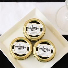 Give your wedding guests the royal treatment by handing over these personalized gold round candy tins.