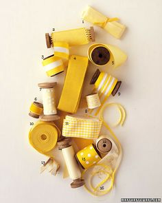 Yellow and White Ribbon and Trim  Narrow ribbons can embellish favor boxes or bind program booklets.    1. Silk ribbon from Tinsel Trading.  2. Vintage picot-edge taffeta ribbon from Hyman Hendler & Sons.  3. Bold grosgrain stripes from Masterstrok...