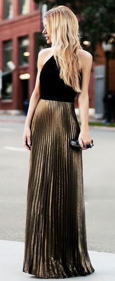 Metallic gold pleated maxi skirt dressed up with a tight black halter top