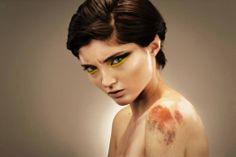 Black and yellow eyeshadow, satin skin, real scar!