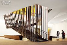 The Conrad New York Hotel | The conference stairway surrounds a structural column and incorporates a custom walnut bench.