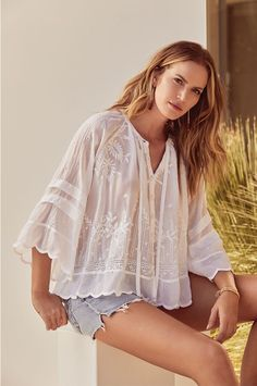 Our Lucca Top boasts flared sleeves, feminine scalloped edges and an ultra-relaxed fit. Super comfortable with a gentle silhouette, this top is accented by delicate tonal floral patterns. This light and subtly transparent tunic adds elegant femininity to your wardrobe; the ultimate addition to any boho chic wardrobe.