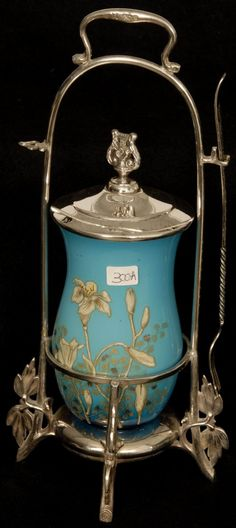 "12"" PICKLE CASTOR: BLUE CASED ARY GLASS INSERT WITH ENAMEL FLORAL DESIGN SET ON ROGERS SILVERPLATE FRAME"