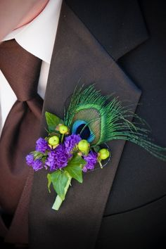 Peacock wedding flower boutonniere, groom boutonniere, groom flowers, add pic source on comment and we will update it. can create this beautiful wedding flower look. Feather Boutonniere, Groom Boutonniere, Boutonnieres, Peacock Wedding Flowers, Peacock Theme, Purple Peacock, Magenta, Wedding Colors, Bridesmaids And Groomsmen