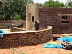 Bullet-Proof Plastic Bottle Homes : plastic bottle homesHouses Being Built in Nigeria Use 7,800 Plastic Bottles Each
