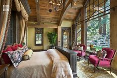 Rustic Master Bedroom with can lights, Exposed beam, Carpet, Chandelier, specialty window, French doors, Standard height