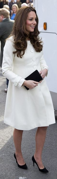 Duchess of Cambridge wearing a princess coat from JoJo Maman Bebe and a black Mulberry clutch.