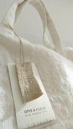 """""""ana & cuca utilize vintage fabrics + simple designs - most elegant! Brand Packaging, Packaging Design, Buch Design, Illustration Mode, Swing Tags, Linen Bag, Linens And Lace, Clothing Labels, Vintage Fabrics"""
