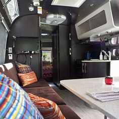 Apartment on wheels: With this much room, you can think about decorating the same way you'd decorate an apartment.    An #Airstream kitchenette with microwave, stovetop, refrigerator, and freezer lets you enjoy home cooking on the road, too.