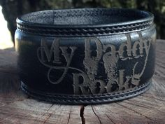 A personal favorite from my Etsy shop https://www.etsy.com/listing/235386185/my-daddy-rocks-lasered-on-a-black