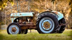 rusty blue tractor