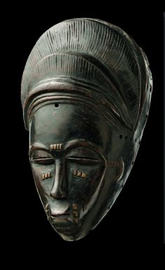 Africa | Mask from the Baule people of Ivory Coast | Wood | April 2013 Catalogue