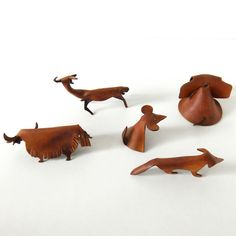 Beautiful hand crafted leather animals in the style of Deru, from the same period 1950s. With there simple lines and characterful postures these endearing