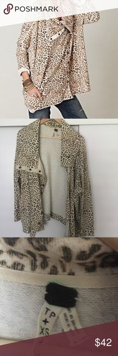 We the Free Terry Cheetah Sweater Purchased a couple years ago, but worn only a couple times. It's time to pass it on to someone else. Size XS but can fit a Small or Medium easily. Like new condition. Part of the Free People brand. Cream and brown colored animal print pattern. Free People Sweaters