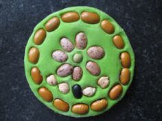 Salt dough bean art! We could make mandalas. Could use other seeds too! I've been looking for a sculpture-like idea like this for our plant exploration!