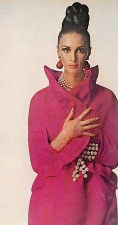 Wilhelmina in ruffled oval cape in cherry red silk by Oscar de la Renta for Jane Derby, photo by Penn for Vogue, 1965