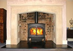 Image result for woodstove in a fireplace