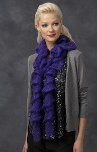 You will be amazed at how easy this Simple Ruffle Scarf is to make. It's seriously one of the quickest free crochet patterns ever. Use one skein of Red Heart Boutique Rigoletto yarn to complete this scarf.
