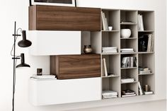 Lugano wall mounted wall system with doors by BoConcept.