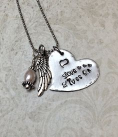 "Tilted Aluminum Heart Pendant, Hand Stamped with ""Love Lives On"", with a Vintage-styled Wing Charm & Wire Wrapped Pearl on Etsy, $27.99"