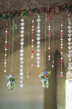 hanging paper garlands - easy DIY! photo by Giuli&Giordi http://ruffledblog.com/san-sebastiano-da-po-destination-wedding #diygarland #weddingdiy #weddingideas