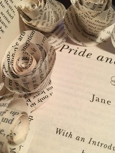 Set of paper flowers made from the pages of Pride and Prejudice by Jane Austen. On bare green wire floral stems. There is an option for them to be wrapped in green floral tape. Just see the drop down menu. Great for individual use or as a wedding bouquet. Want a customer order? Just ask! I can find most books to make paper products out of.