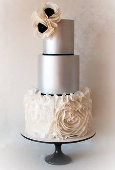 Modern Metallic Three-Tier Round Wedding Cake With Ruffled Rosettes