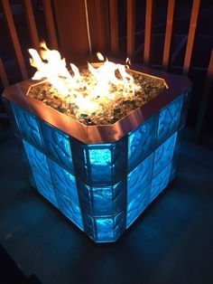 Free standing fire pit by Monroe Fireplace and Seattle Glass Block. The lights in the base can change colors, combined with the flames--so mesmerizing!