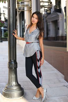 metallic silver blouse with sporty pants and ballet flats
