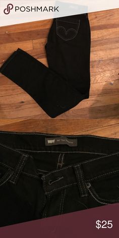 Levi's black skinnies Size 9 Levi's 524 black with white stitching...NWOT...very flattering Levi's Jeans Skinny