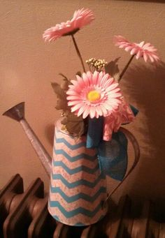 Watering can with Gerber daiseys ,teal and pink
