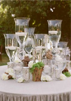 A use for all those crystal goblets that always seem to fall into one's life! They could be chipped, mismatched, dated, even ugly.  Put enough of any one kind of object together and things look better!