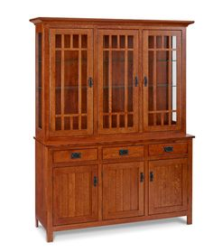 Camden Mission Hutch:  Our Camden Mission hutch in quarter sawn oak is built in the true Mission spirit. Mullioned glass doors, dovetail joinery and black iron hardware are exactly as they were more than 100 years ago. Contemporary lighting, glass upper shelves and full extension glides combine the best of the old and new. Shown in quarter sawn oak with our Enfield finish. Also available in cherry.     www.chiltons.com     #hutch #quality #storage #diningroom #furniture