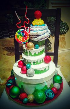 Whoville cake prop for my Christmas program. Made from a hat box, dollar store foam shapes, cup cake dog toy, and ornaments. Voila!