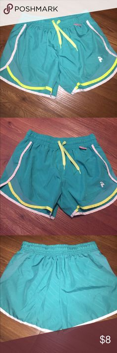 FILA Athletic workout shorts XS FILA  Workout running shorts X-SMALL XS Used good condition- Great for working out at the gym running exercising- teal green- built in underwear-see last photo Fila Shorts