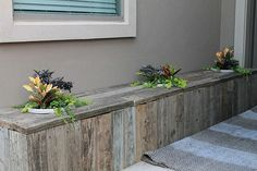 Outdoor planter/bench made out of a pallet! Also would be cute bench with storage inside and cushions on top to sit on.
