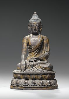 A LACQUERED BRONZE FIGURE OF BUDDHA, CHINA, QING DYNASTY, 17TH CENTURY