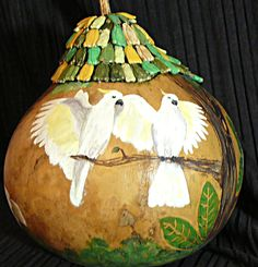 Hand painted hollow gourd that is painted 360 with cockatoos. The top is a tree made from gourd seeds.  Donated to A Parrot Perch Rescue for fundraising!