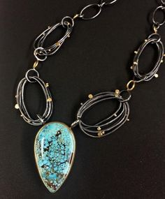 Sydney Lynch  necklace with a beautiful spiderweb turquoise from a collection cut in the 70's. Oxidized silver, 18k & 22k gold. Pendant is 1 3/8-inch long on an 18-inch chain. $2,990.