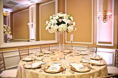 Wedding, Flowers, Reception, White, Gold - I like how clear/thin the vase is, no worrying about people not being able to see each other from across the table!