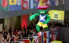 The 2014  Commonwealth Games mascot Clyde is hoisted onto a  stage at the BBC Studios in Glasgow